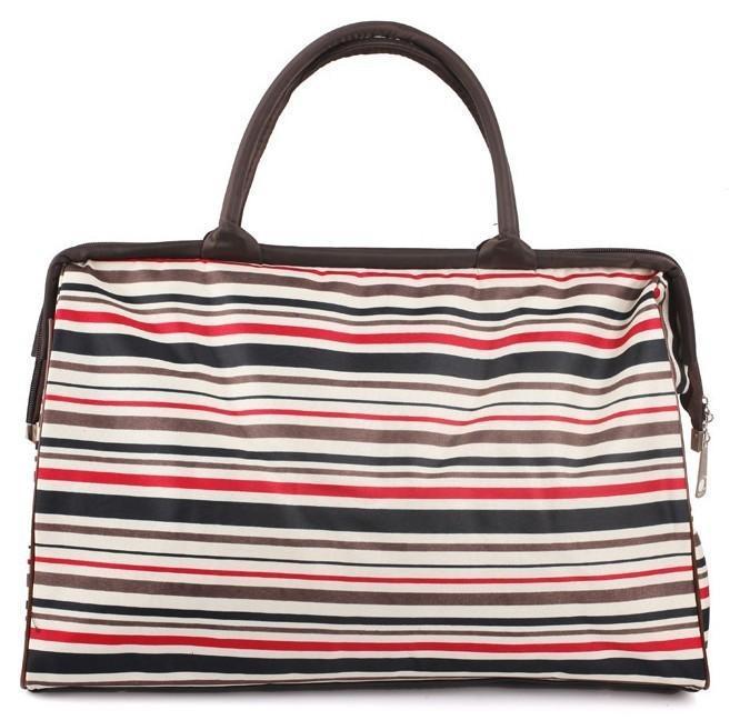 Вместительная дорожная женская сумка