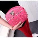Женская сумка декорированная заклепками